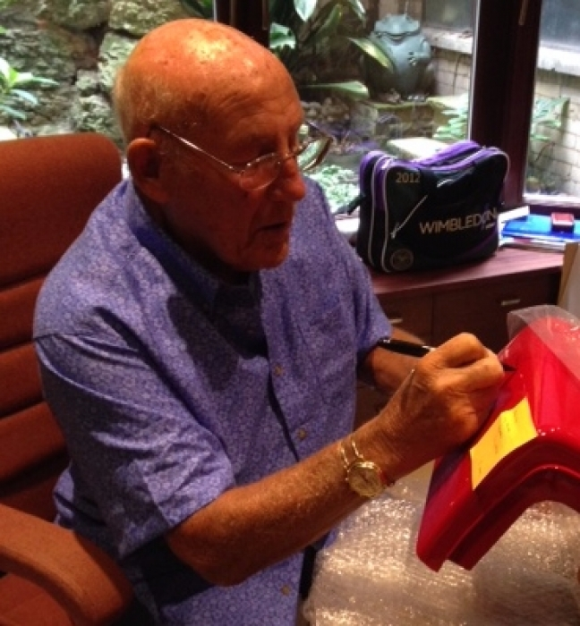 Sir Sterling Moss signing one of our vintage pumps We have some great items signed by the legend