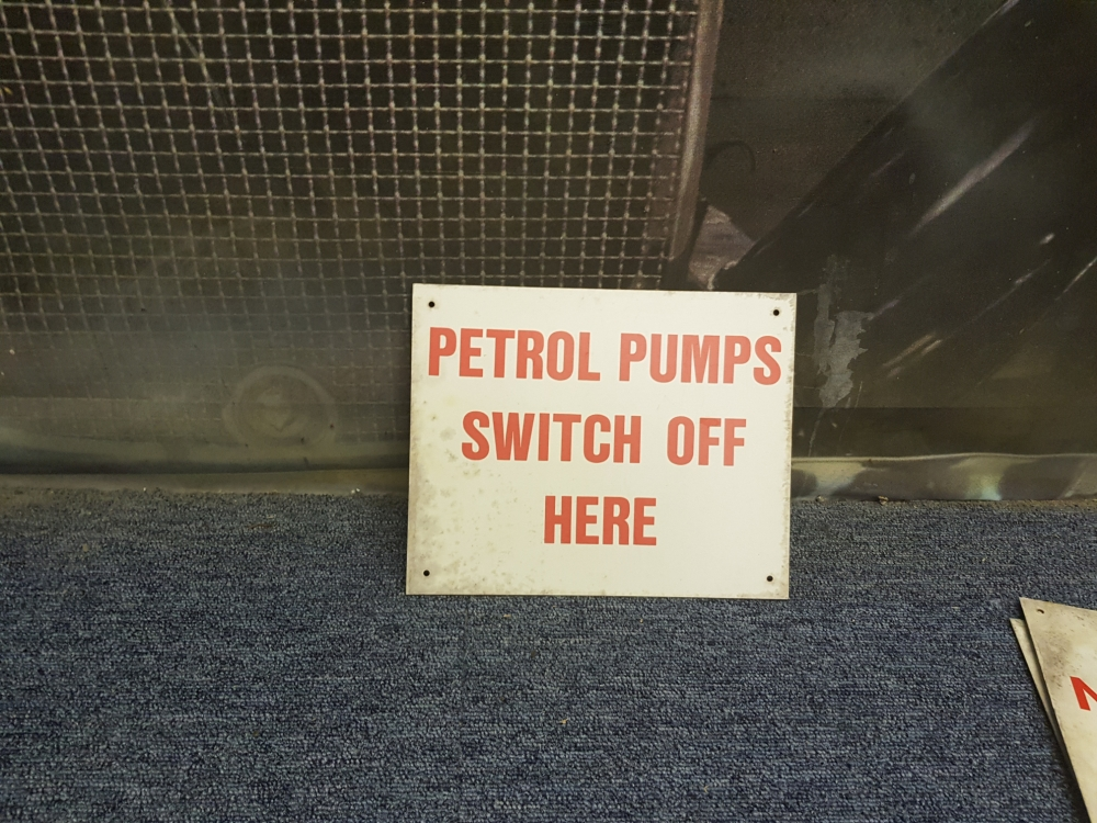 Petrol pumps switch off here sign