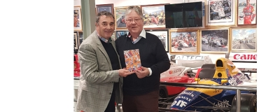 NIGEL MANSELL with our new book he has written the foreward